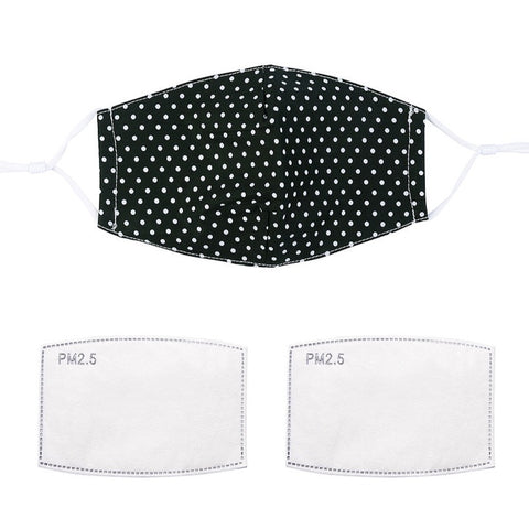 Fashionable face mask with a black and white polka dot printed fabric design.