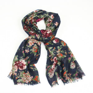 Beautiful vintage style flower and butterfly printed scarf with dark blue background, finished with a feathered edge