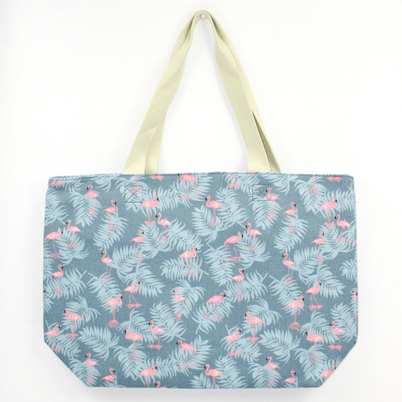 Large canvas bag with tropical flamingo design print, on a solid blue coloured background
