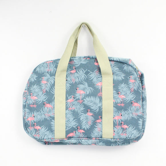Tropical flamingo design print weekend bag on a solid blue coloured background.