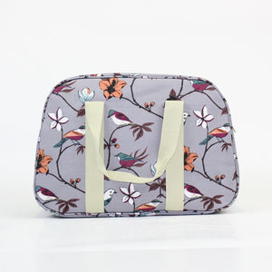 Gorgeous bird and flower print on a solid grey coloured background.