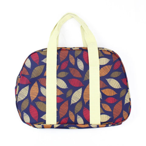 Autumn seasonal leaf print weekend bag, on a solid dark blue coloured background.