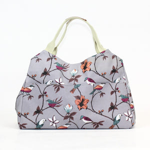 Gorgeous bird and flower print multi-functional day bag on a grey coloured background.