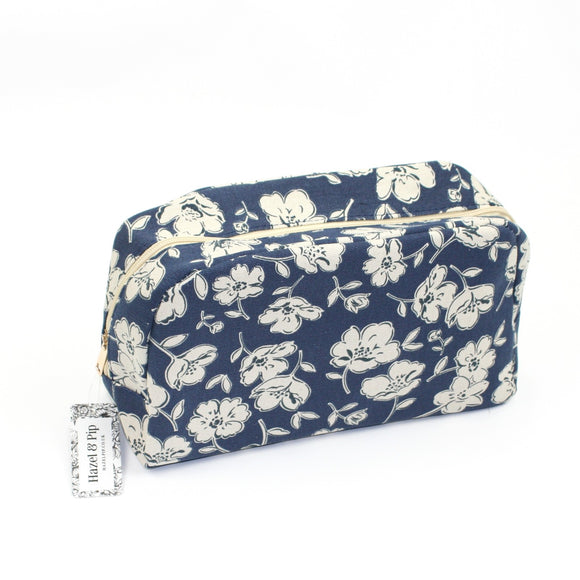 Large make up / wash bag with primrose print, on a solid dark blue coloured background