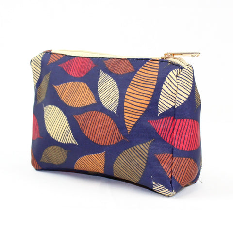 Autumn seasonal leaf print on blue background make up bag.