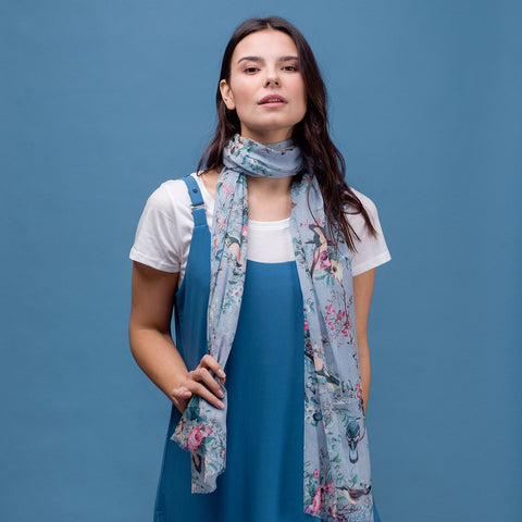Delicate butterfly and bird print scarf in blue with rolled edge.