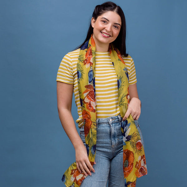 Bold and pretty this anemone floral print scarf is inspired by a summer meadow. Yellow with vibrant red and blue flowers.