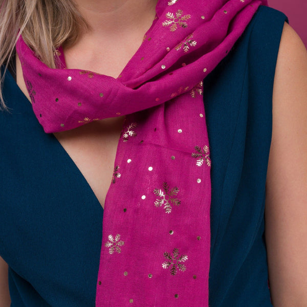 Delicate snowflake foil print pink scarf, finished with a rolled edge.