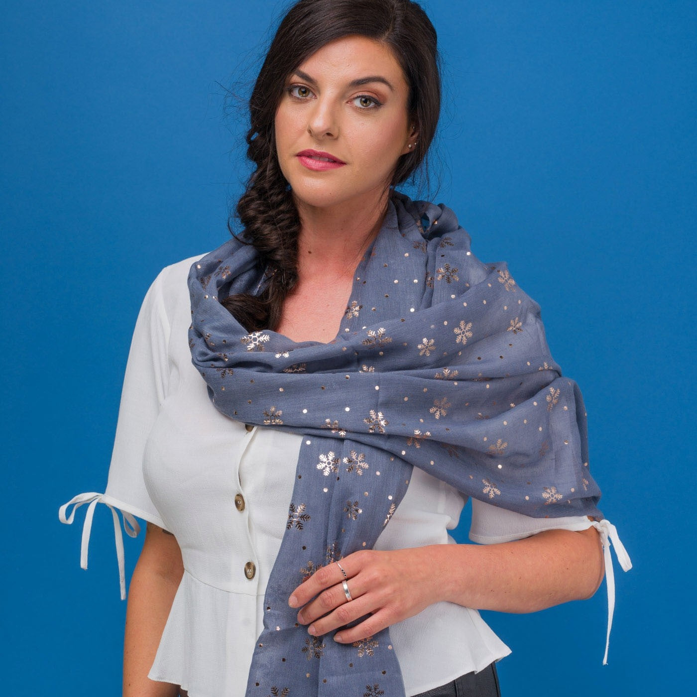 Delicate snowflake foil print grey scarf, finished with a rolled edge.