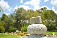 An all natural organic bar soap from Derek Products on top of a rock