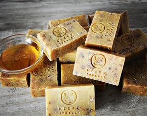 A stack of honey and oatmeal bar soaps from Derek Products