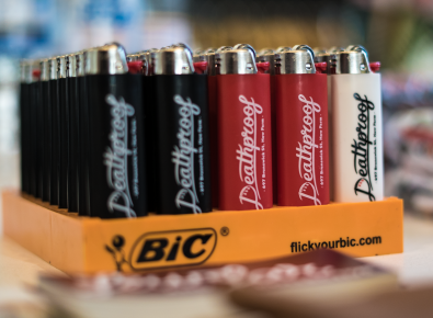 Custom printed BIC lighters by Few and Far Studio