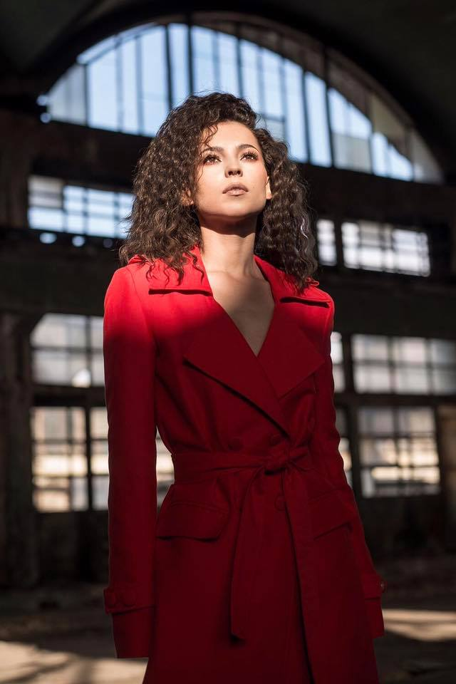 AMI wearing OMRA red cotton trench in her music video