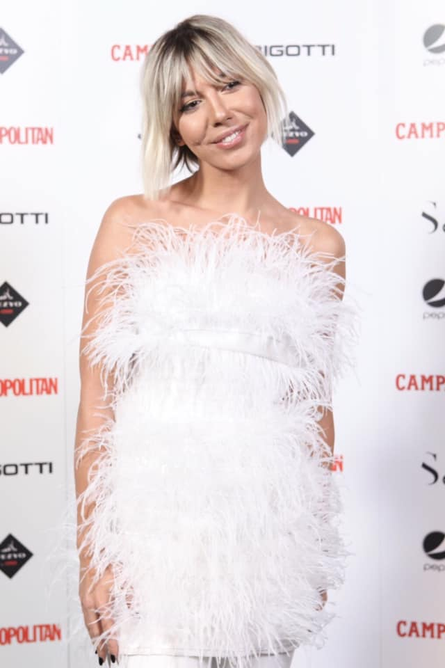 Sore gorgeous in OMRA white feathers dress at Cosmopolitan Anniversary Party!
