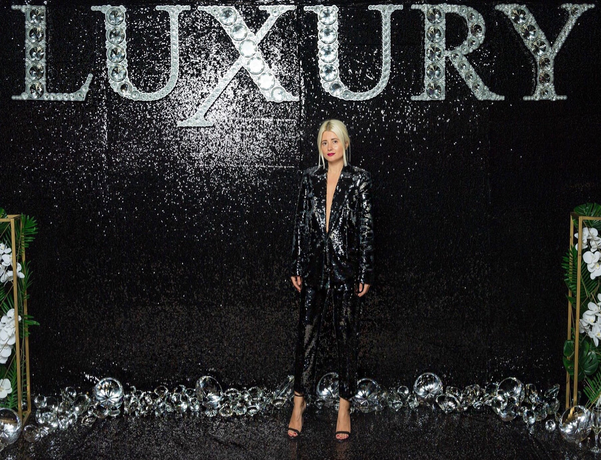 Chrisa Dobreanu shinning in OMRA sequins suit at Luxury Magazine Anniversary Party