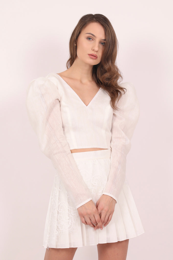 White embroidered cotton top with oversized sleeves.