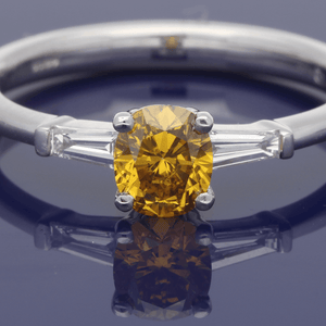 Platinum Fancy Natural Yellow Solitaire Ring with Tapered Baguette Set Shoulders
