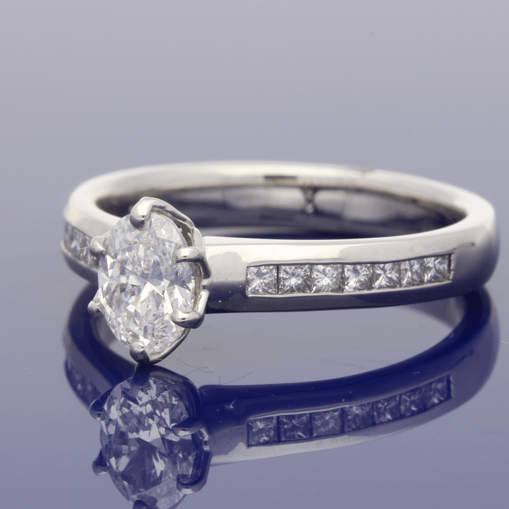 Platinum Certificated 0.70ct Oval Diamond Solitaire Engagement Ring with Princess Cut Diamond Shoulders