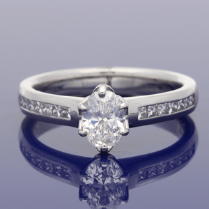 Platinum Oval Solitaire with Princess Cut Diamond Shoulders