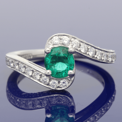 Platinum Emerald & Diamond Cross-Over Dress Ring