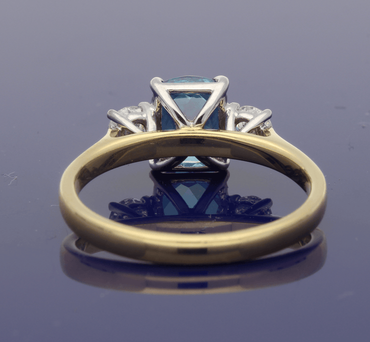 18ct Yellow Gold Cushion Cut Blue Zircon and Diamond Trilogy Ring