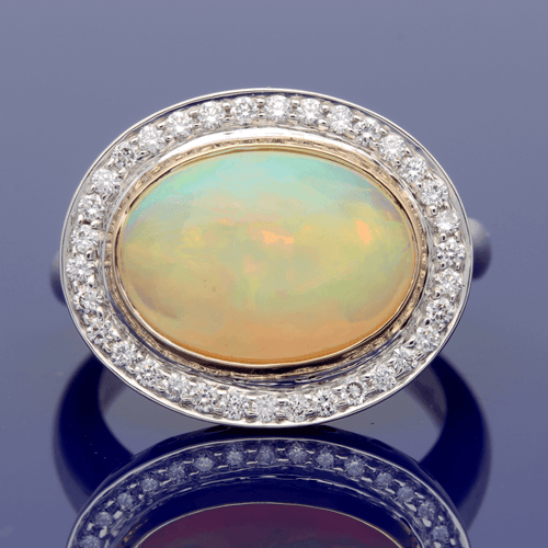 18ct White Gold Opal & Diamond Oval Cluster Ring