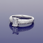 Platinum Certificated 0.78ct Emerald Cut Diamond with 0.57ct Pave Set Diamond Shoulders
