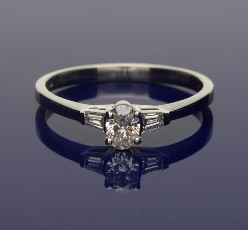 Platinum Oval Cut Diamond 0.26ct With Baguette Cut Diamond Shoulders 0.13ct, Claw Set Ring