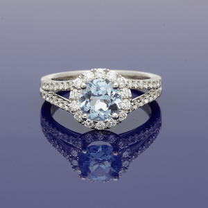 18ct White Gold and Aquamarine Halo Ring with Diamond Set Shoulders