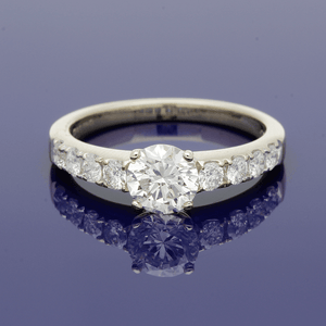 18ct White Gold Round Brilliant Cut Diamond Ring With Diamond Set Shoulders