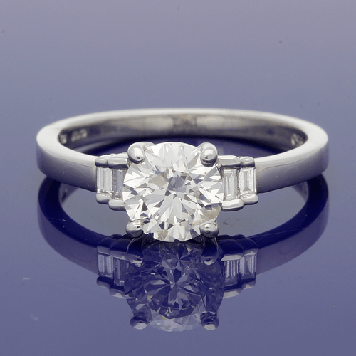 Platinum round brilliant Cut Solitaire with Diamond Set Shoulders Ring