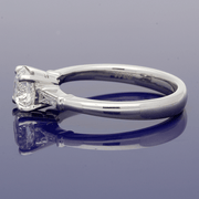 Platinum Certificated 0.91ct Diamond Ring with Tapered Baguette Set Shoulders