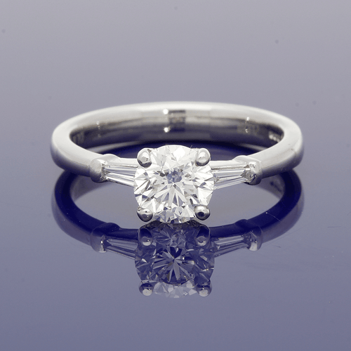 Platinum Solitaire Ring with Tapered Baguette Set Shoulders