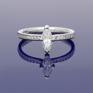 Platinum & Diamond Marquise Cut Solitaire Ring with Diamond Set Shoulders