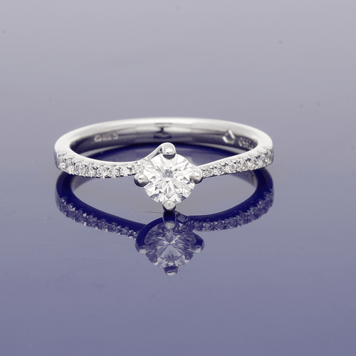 Platinum & Diamond Round Brilliant Cut Solitaire Ring with Diamond Set Shoulders