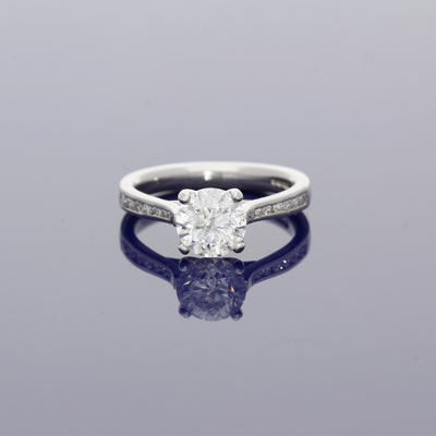 Platinum and Diamond Solitaire Ring with Diamond Set Shoulders