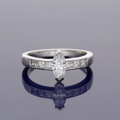 Platinum 0.51ct Marquise Cut Diamond Solitaire Ring with Princess Cut Diamond Set Shoulders