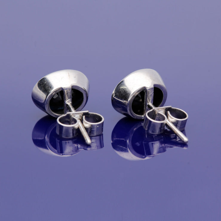 9ct White Gold Dark Sapphire Oval Cut Rub Over Set Stud Earrings
