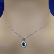 18ct White Gold Sapphire and Diamond Pendant