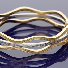 18ct Yellow Gold, 18ct White Gold and 18ct Rose Gold Wave Design Bangle
