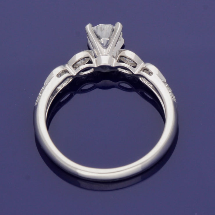 Platinum 0.56ct Solitaire with Diamond Set Shoulders Ring
