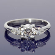 18ct White Gold Certificated 0.90ct Diamond Trilogy Ring with Pear Shape Diamond Set Shoulders