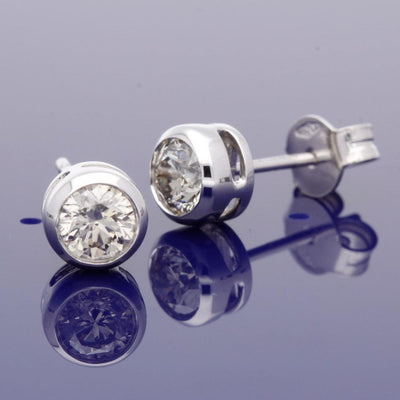 18ct White Gold Rub-Over Set 0.70ct Diamond Stud Earrings