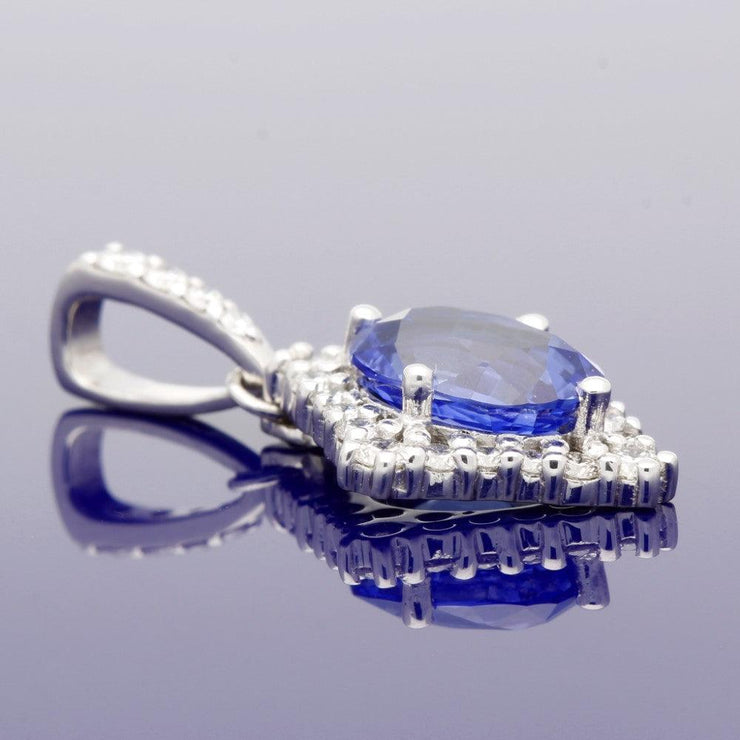 18ct White Gold Oval Sapphire Pendant with Diamond Halo Setting