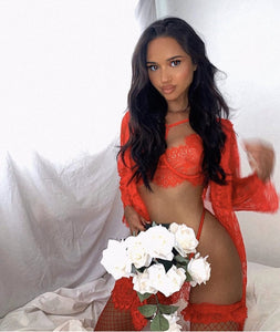 GLOWING red lace robe