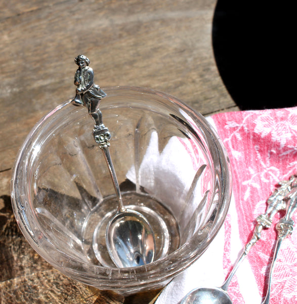 Silver spoons with musician finials