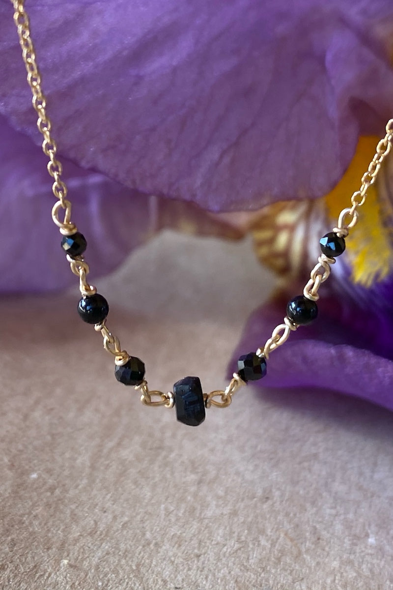 minimal and simple black gold necklace
