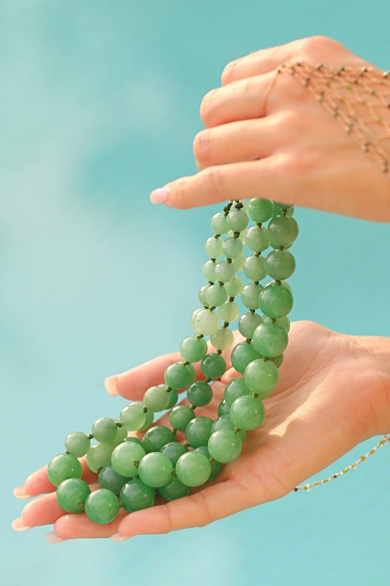 wear an elegant gemstone necklace at the pool
