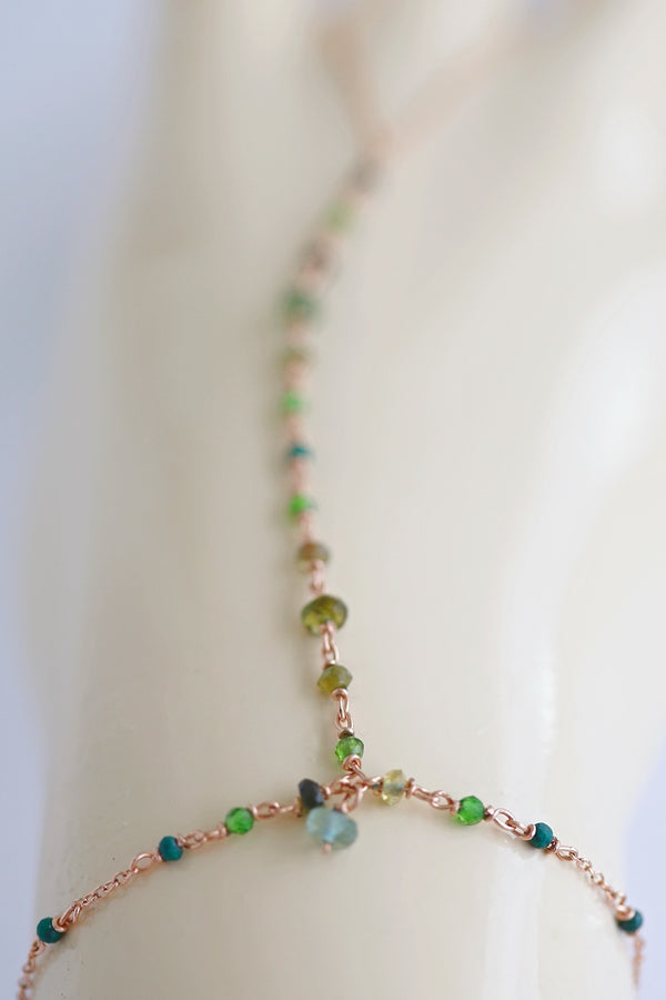 green gemstone hand chain jewelry