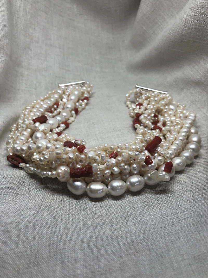 wear a pearl and coral choker with your every day outfit